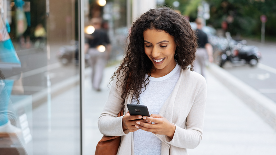 Woman looking at her phone and smiling.